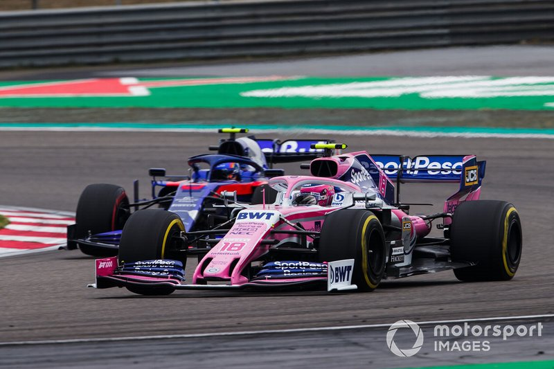Lance Stroll, Racing Point RP19 and Alexander Albon, Toro Rosso STR14 battle