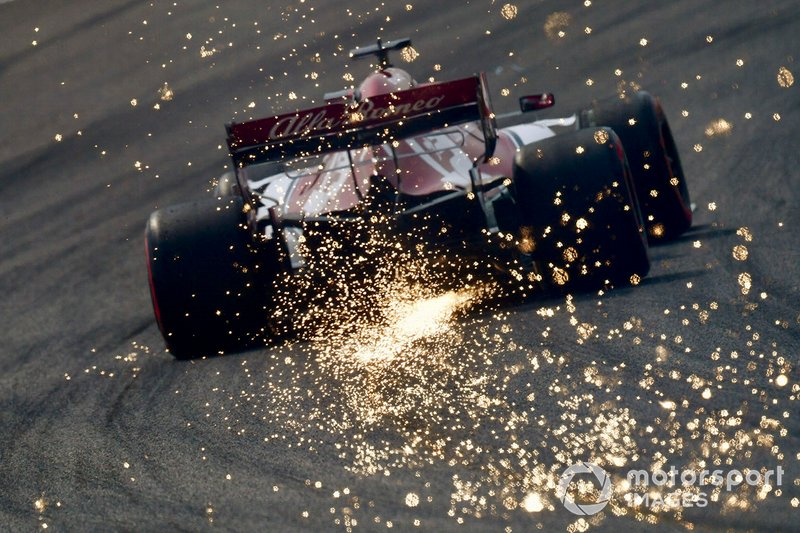 Sparks kick up from the rear of Kimi Raikkonen, Alfa Romeo Racing C38