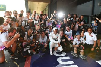 Lewis Hamilton, Mercedes AMG F1, celebrates pole with a group of photographers