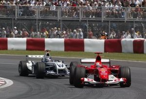Michael Schumacher, Ferrari F2004 leads Juan Pablo Montoya, Williams BMW FW26