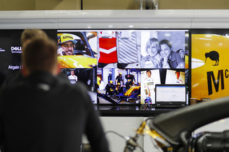 Screens depicting classic James Hunt and Fernando Alonso, McLaren, imagery, in the team's garage