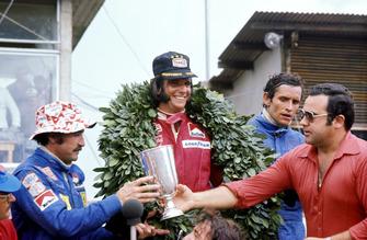 The podium (L to R): Clay Regazzoni, Ferrari second; Emerson Fittipaldi, McLaren winner; Jacky Ickx, Lotus third.