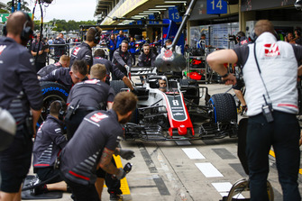The Haas team conduct a practice pit stop with Formula 2 racer and development driver Louis Deletraz at the wheel
