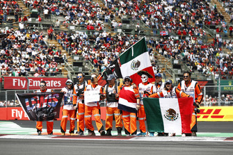Marshals show some patriotism and support for drivers prior to the start
