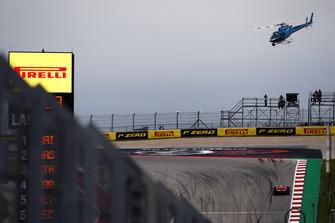 The TV helicopter hovers above Kimi Raikkonen, Ferrari SF71H