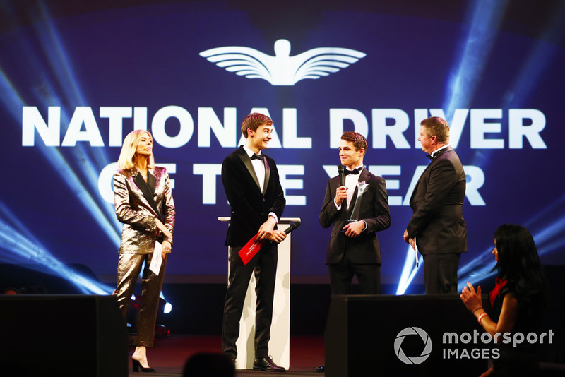 Williams F1 Driver George Russell, and McLaren F1 driver Lando Norris on stage to present the National Racing Driver Award to Dan Ticktum