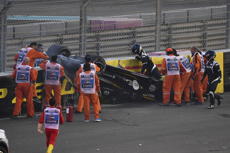 Medics and marshals assist Nico Hulkenberg, Renault Sport F1 Team R.S. 18 who crashed and rolled on lap one