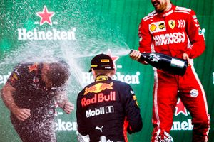 Max Verstappen, Red Bull Racing, 1st position, and Sebastian Vettel, Ferrari, 2nd position, spray Champagne on the podium