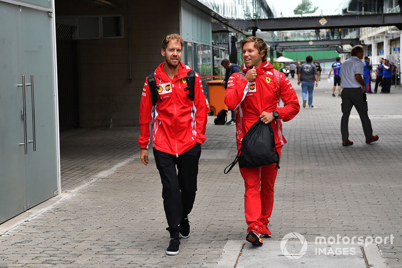 Sebastian Vettel, Ferrari with his trainer Antti Kontsas