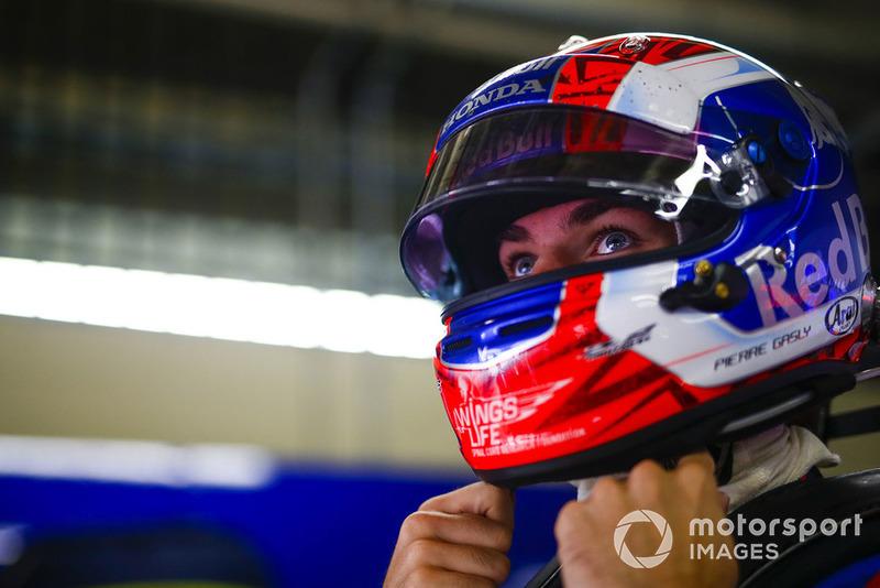 Pierre Gasly, Toro Rosso, adjusts his helmet