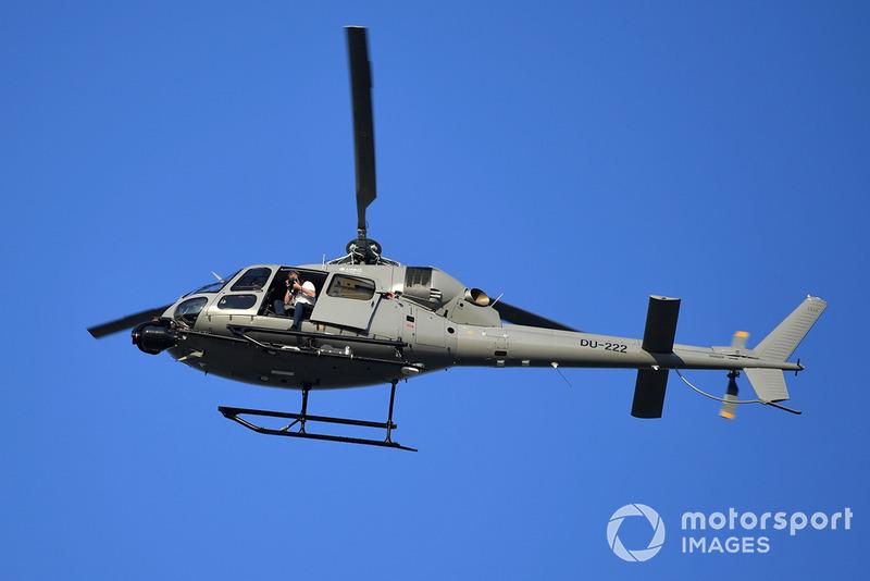 Helicóptero y fotógrafo