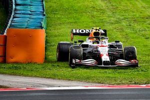 Sergio Perez, Red Bull Racing RB16B, on the grass