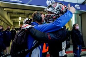 Juri Vips, Hitech Grand Prix, 2nd position, celebrates with a team mate in Parc Ferme