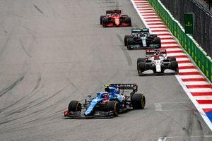Esteban Ocon, Alpine A521, Kimi Raikkonen, Alfa Romeo Racing C41, and Sebastian Vettel, Aston Martin AMR21