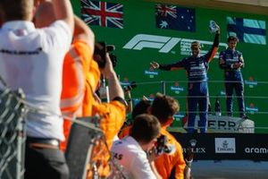 Daniel Ricciardo, McLaren, 1st position, performs a shoey on the podium