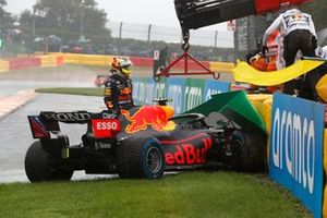 Sergio Perez, Red Bull Racing RB16B, crashes out on his way to the grid