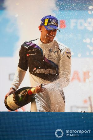 Jake Dennis, BMW I Andretti Motorsport, first position, sprays the victory Champagne