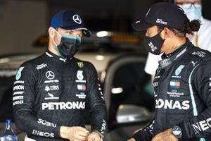 Valtteri Bottas, Mercedes-AMG F1, and Lewis Hamilton, Mercedes-AMG F1, talk in Parc Ferme after Qualifying