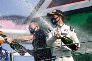 The AlphaTauri trophy delegate sprays Champagne with Pierre Gasly, AlphaTauri, 1st position