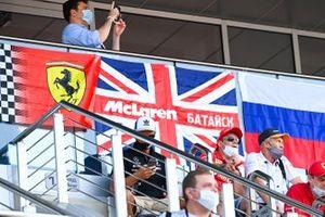 McLaren and Ferrari fans in a grandstand