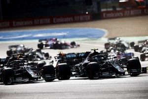 Valtteri Bottas, Mercedes F1 W11 and Lewis Hamilton, Mercedes F1 W11 battle at the start of the race