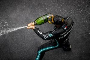 Lewis Hamilton, Mercedes-AMG F1, 1st position, celebrates on the podium with champagne