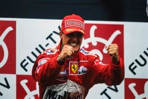 Michael Schumacher, 1st position, celebrates victory and securing his third drivers' title on the podium