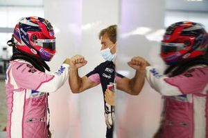 Sergio Perez, Racing Point, with an engineer