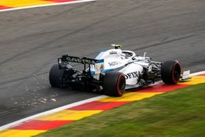Sparks fly from the car of Nicholas Latifi, Williams FW43