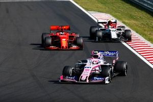 Lance Stroll, Racing Point RP19, leads Sebastian Vettel, Ferrari SF90, and Antonio Giovinazzi, Alfa Romeo Racing C38