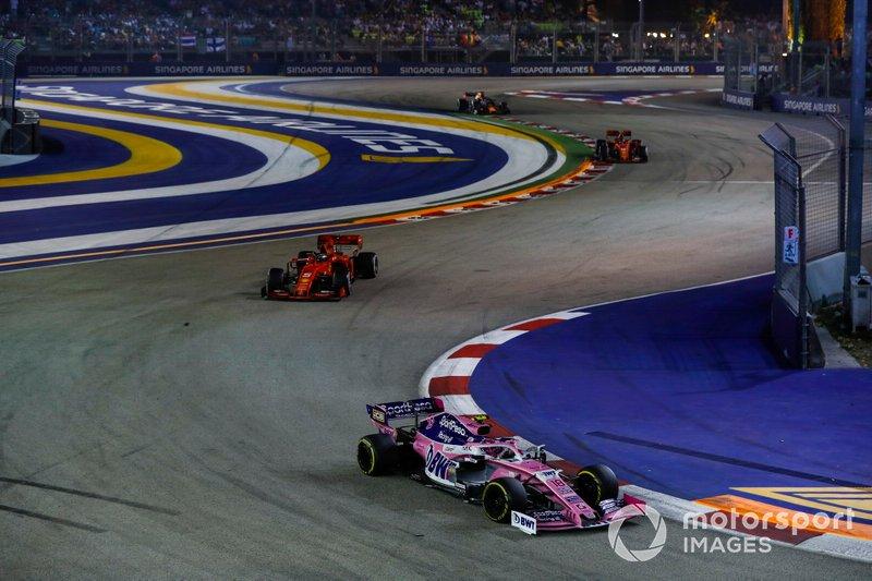 Lance Stroll, Racing Point RP19, leads Sebastian Vettel, Ferrari SF90, and Charles Leclerc, Ferrari SF90