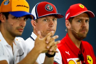 Carlos Sainz Jr., McLaren, Kimi Raikkonen, Alfa Romeo Racing and Sebastian Vettel, Ferrari in the Press Conference