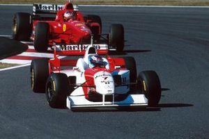 Mika Häkkinen, McLaren MP4/11, Michael Schumacher, Ferrari F310