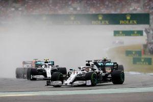 Lewis Hamilton, Mercedes AMG F1 W10, leads Kevin Magnussen, Haas F1 Team VF-19, and Valtteri Bottas, Mercedes AMG W10