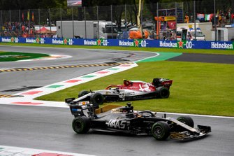 Romain Grosjean, Haas F1 Team VF-19, passes as Antonio Giovinazzi, Alfa Romeo Racing C38, spins