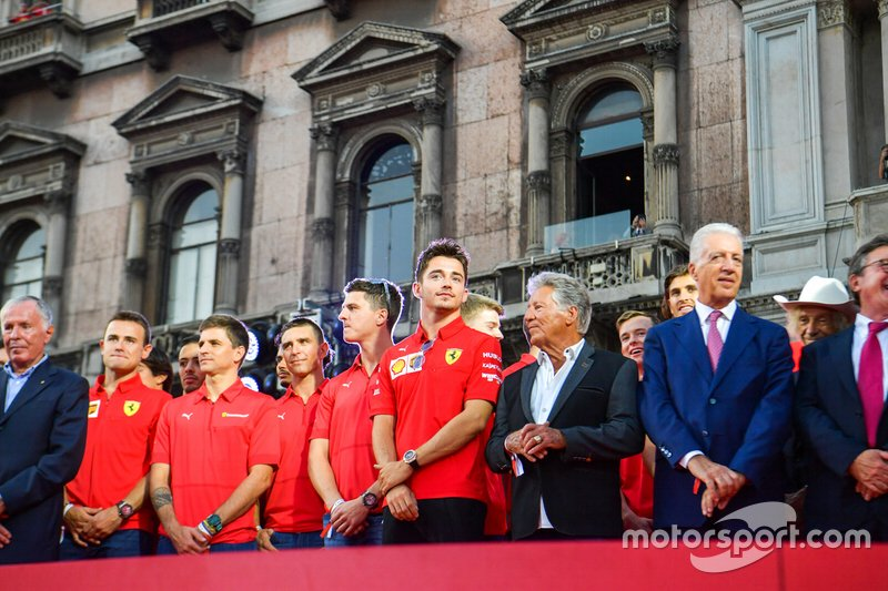 Charles Leclerc, Ferrari stands next to Mario Andretti