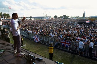 Lewis Hamilton, Mercedes AMG F1, 1st position, on stage celebrating with his home fans after the race