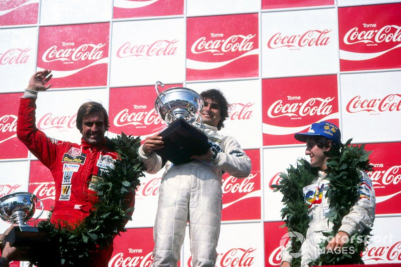 Podium: Race winner Nelson Piquet, Brabham, second place Carlos Reutemann, Williams, third place Alain Prost, Renault