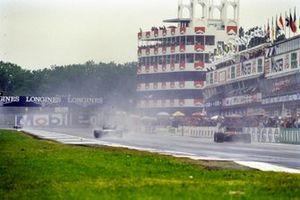 A Brabham BT54 BMW, leads an Alfa Romeo 185T