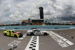 Chase Briscoe, Stewart-Haas Racing, Ford takes the checker flag ahead of Brandon Jones, Joe Gibbs Racing, Toyota Supra