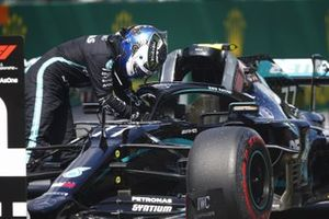 Valtteri Bottas, Mercedes F1 W11 EQ Performance, climbs from his car after taking Pole Position