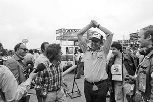 Ken Tyrrell, Tyrrell Team Owner celebrates after winning a pit stop tyre change competition against the McLaren team