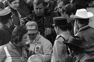 Race winner Jackie Stewart, Tyrrell after the podium ceremony