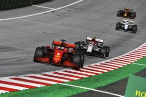 Sebastian Vettel, Ferrari SF1000, leads Antonio Giovinazzi, Alfa Romeo Racing C39, and Nicholas Latifi, Williams FW43