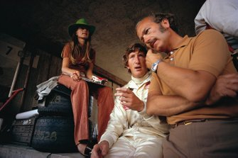 Jochen Rindt in pits with wife Nina and Lotus team boss Colin Chapman
