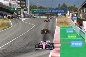 Sergio Perez, Racing Point RP20, leads Alex Albon, Red Bull Racing RB16, and Carlos Sainz Jr., McLaren MCL35