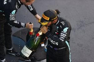 Lewis Hamilton, Mercedes-AMG Petronas F1, 1st position, Valtteri Bottas, Mercedes-AMG Petronas F1, 3rd position, on the podium with Champagne