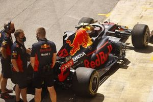 The Red Bull team practise pit stops using the Alexander Albon Red Bull Racing RB16