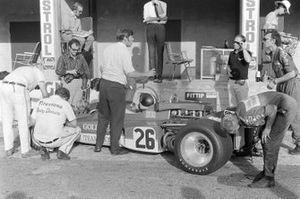 Mechanics work on Emerson Fittipaldi's Lotus 72C Ford