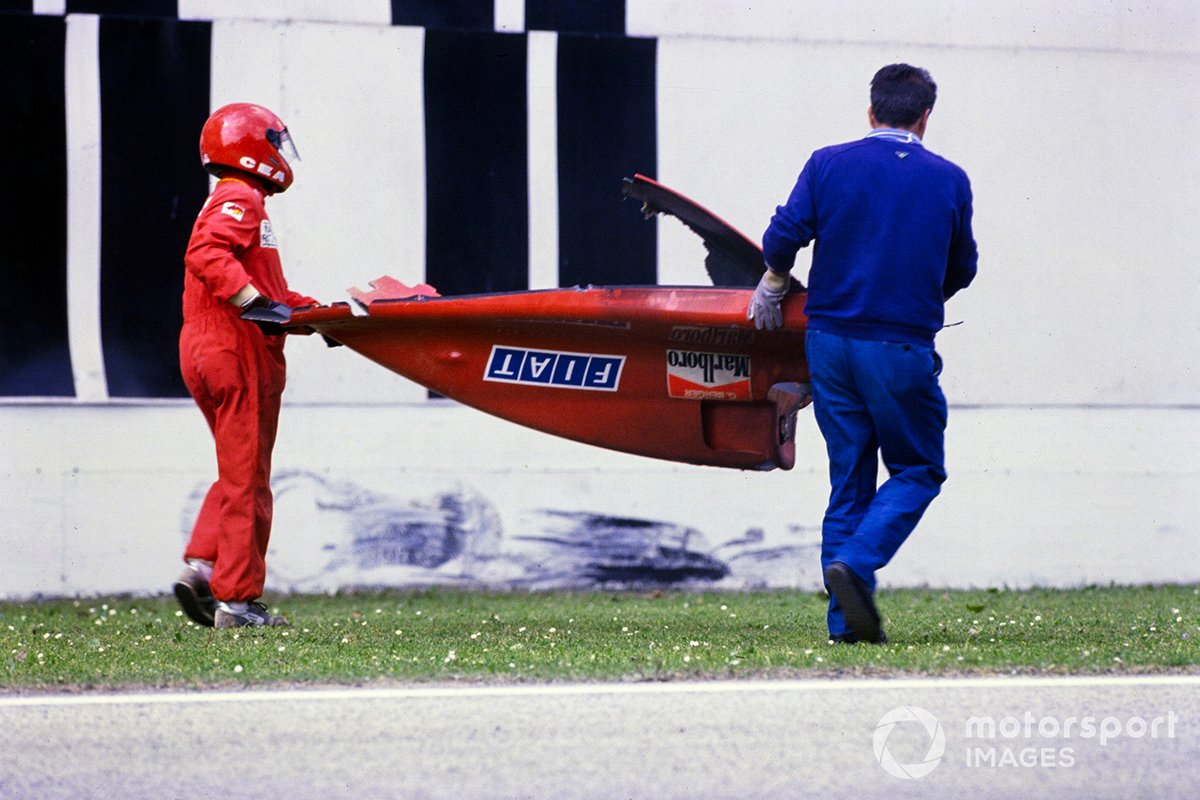 Marshals carry away the rear bodywork of Gerhard Berger's Ferrari 640 after a crash